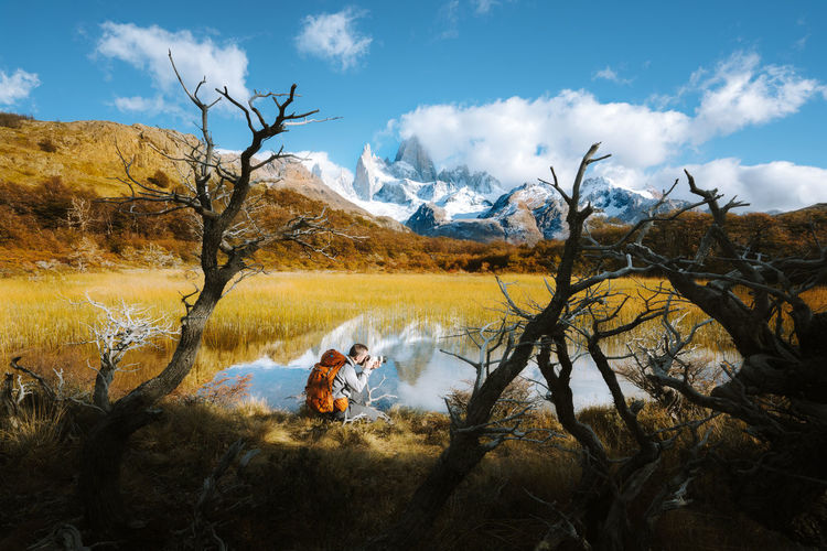Check out my prints at https://simonmigaj.com/shop/ and visit my IG http://www.instagram.com/simonmigaj for more inspirational photography from around the world. Tree Nature Non-urban Scene Plant Real People Sky Scenics - Nature Tranquility Water Beauty In Nature Day Bare Tree Cloud - Sky Mountain One Person Outdoors Patagonia Argentina Fitz Roy Reflection Background Backgrounds Autumn Travel Landscape Branch Tranquil Scene Lifestyles