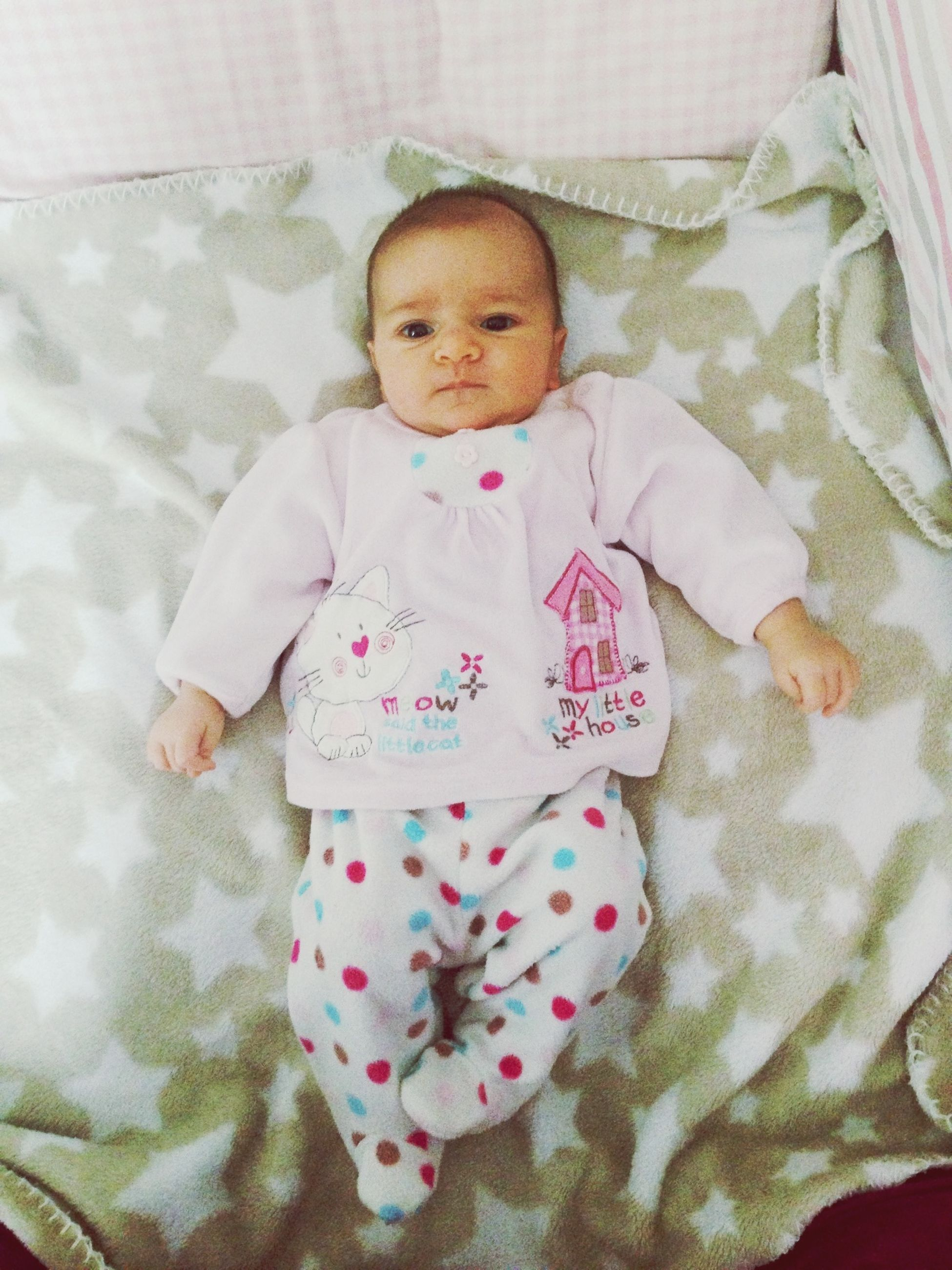 baby, real people, high angle view, babyhood, baby clothing, indoors, one person, relaxation, bed, front view, crib, babies only, day, newborn, mammal, people