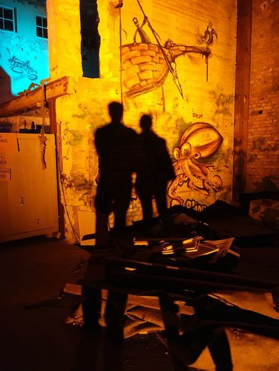 Love Night Shadow Men Two People Architecture Real People Built Structure City Graffiti Silhouette Standing