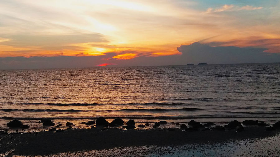 Beautiful Nature Kuala Selangor Malaysia Peaceful View Remis Beach Beach Beauty In Nature Cloud - Sky Day Horizon Over Water Idyllic Nature No People Outdoors Scenics Sea Silhouette Sky Sun Sunset Tranquil Scene Tranquility Water Wave Waves Sound Windy