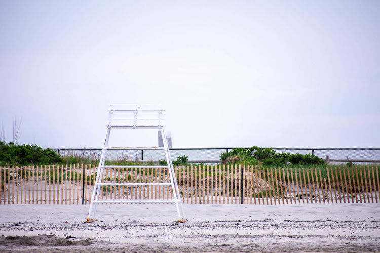 Absence Architecture Barrier Beach Beachphotography Boundary Built Structure Copy Space Day Fence Land Nature No People Outdoors Railing Safety Sand Sea Sky Water