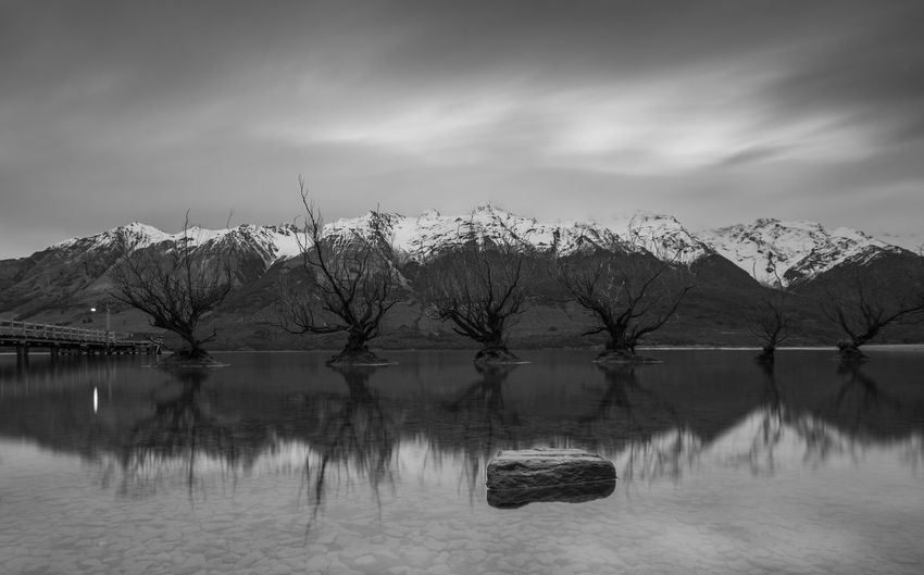 Water Cloud - Sky Sky Beauty In Nature Tranquil Scene Scenics - Nature Tranquility Mountain Lake Reflection Nature No People Mountain Range Tree Cold Temperature Snowcapped Mountain Blackandwhite Black And White Long Exposure Glenorchy New Zealand