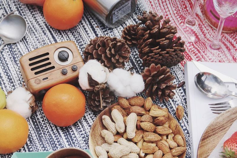 High Angle View Of Food By Pine Cones On Table