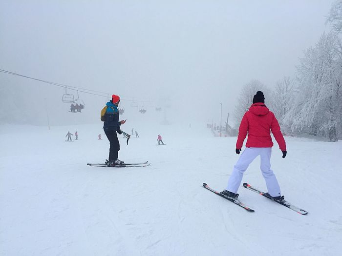 People skiing on snow during winter