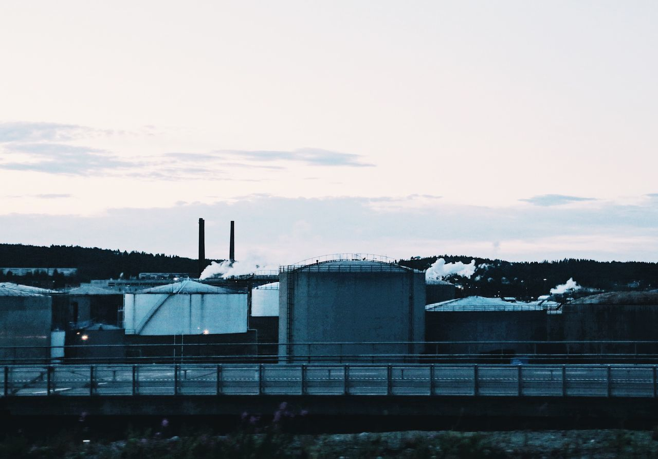 factory, industry, built structure, architecture, sky, no people, smoke stack, fuel and power generation, storage tank, building exterior, outdoors, chimney, day, water, power station, nature