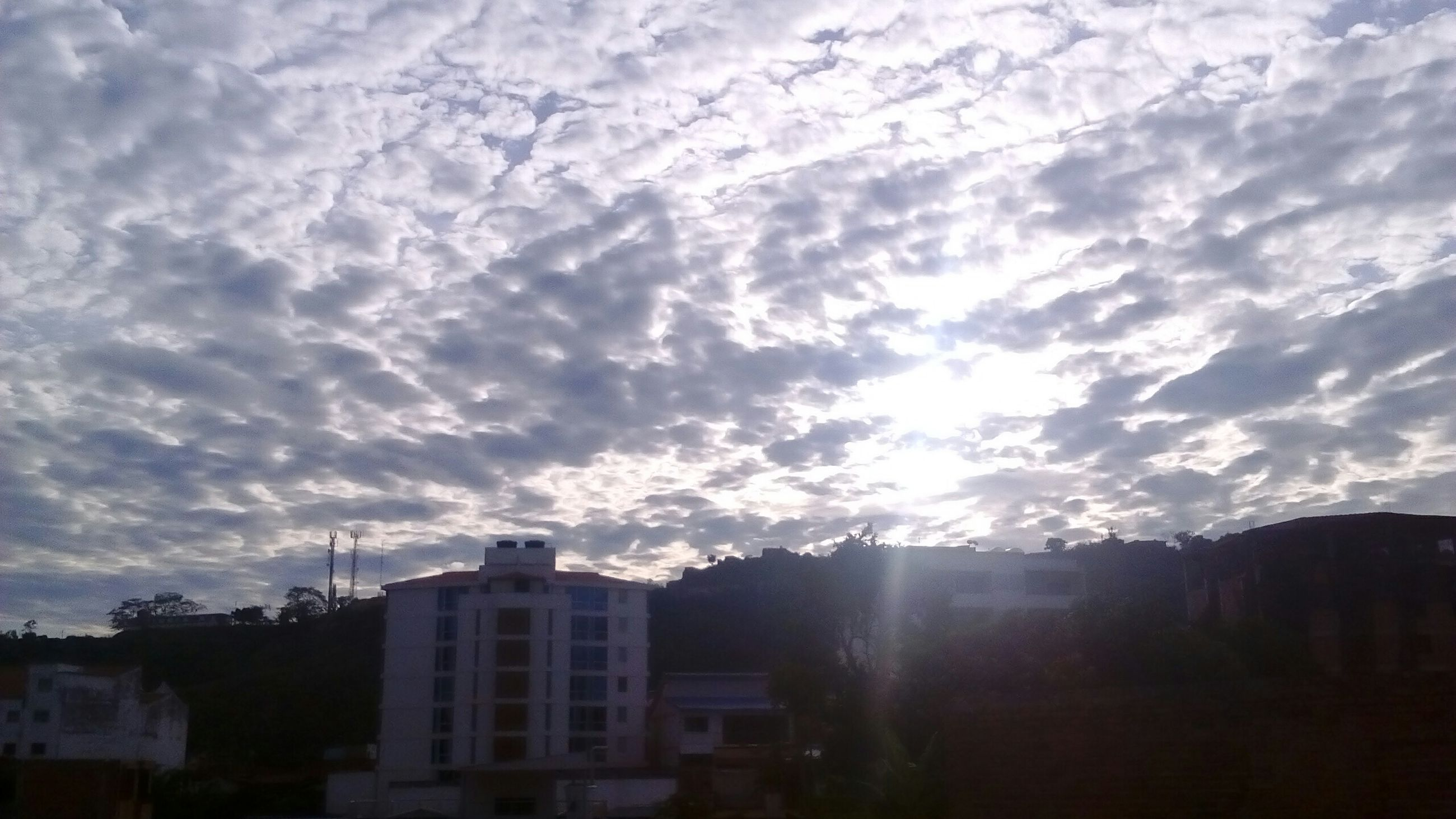 sky, cloud - sky, building exterior, architecture, built structure, cloudy, weather, cloud, beauty in nature, scenics, house, nature, sunbeam, sunset, tranquility, tranquil scene, mountain, silhouette, sunlight, landscape