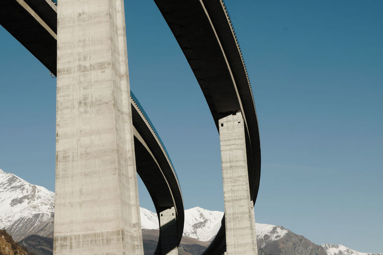 Engineering Man Made Structure Columns Pillars Highway Autostrada A32 Chiomonte Sopraelevata Causeway Elevated Road Elevated Scar Scared Gash Concrete Concrete Structure Alps Alps Italy Val Di Susa Susa Mountain Mountain Range Low Angle View From The Bottom Clear Sky Piedmont Piemonte Concrete Jungle Suspension Bridge