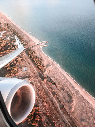High angle view of sea seen through airplane window