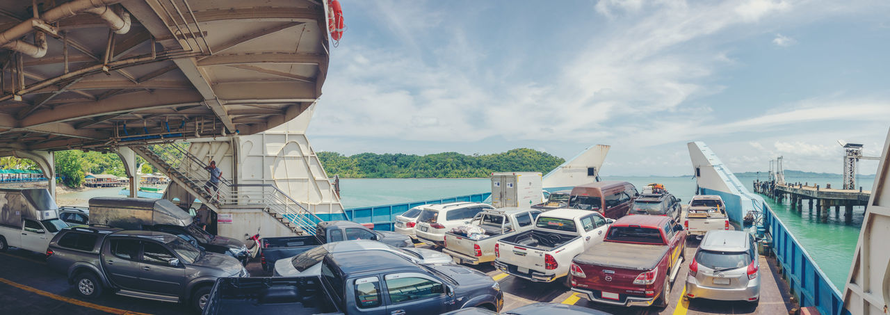 Transportation Mode Of Transportation Nautical Vessel Water Sky Travel Car Nature Moored Cloud - Sky Architecture Day Motor Vehicle Sea Built Structure Harbor No People Arts Culture And Entertainment Travel Destinations Outdoors Luxury Passenger Craft Cruise Ship Rest Travel