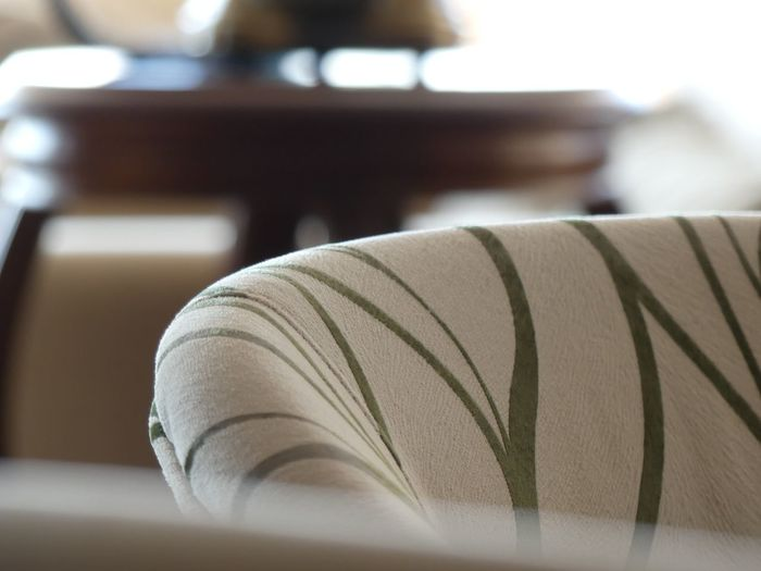 Close-up of sofa on table at home