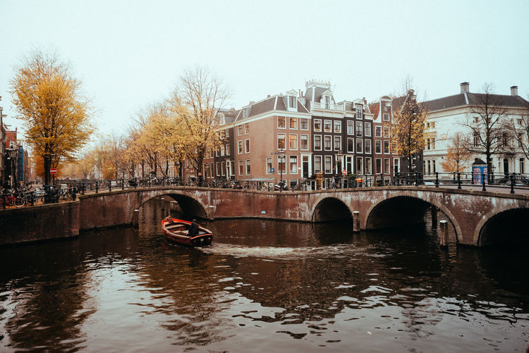 A November in Amsterdam Architecture Built Structure Bridge Transportation Bridge - Man Made Structure Water Connection City Mode Of Transportation Building Exterior River Sky Tree Waterfront Arch Bridge Canals And Waterways Canals Urban Urban Geometry Waterway Europe Europe Trip Travel Destinations November