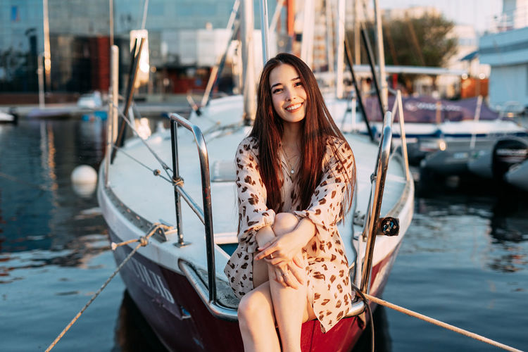 Portrait of young woman in boat