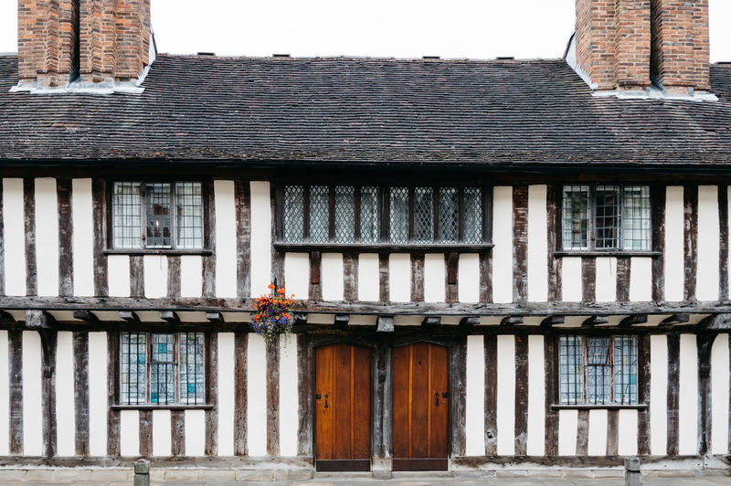 Tudor style house Architectural Column Architecture Brick Wall Building Building Exterior Built Structure City Day Exterior Façade Historic House No People Old Outdoors Residential Building Sky Stratford-upon-Avon Street Timber Tudor Urban