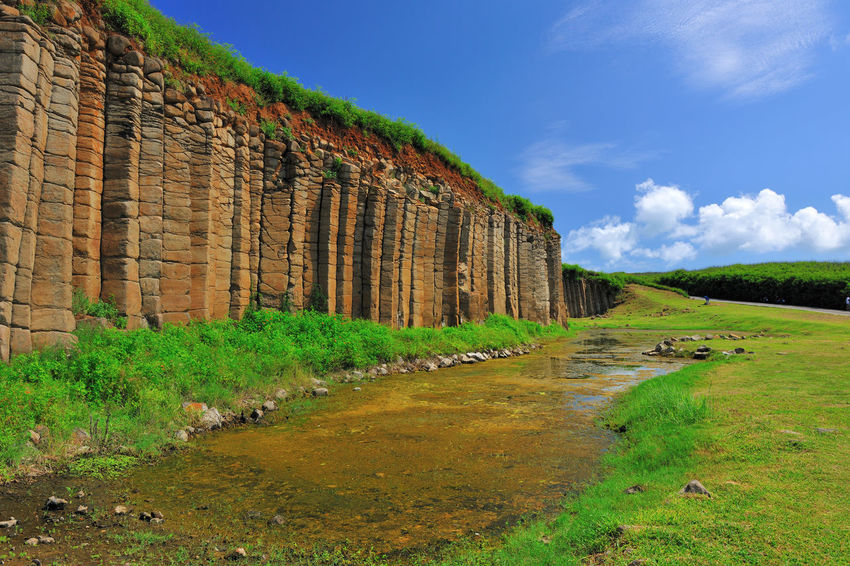 Magnificent basalt walls, wide and beautiful landscape. Natural Rock Formation Rock Wall Ancient Ancient Civilization Basalt Basalt Columns Basalt Rock Beauty In Nature Broadcasting Cloud - Sky Day Field Grass Green Color Landscape Nature No People Old Ruin Outdoors Peaceful Scenics Sky Tranquil Scene Travel Destinations