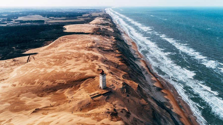 Denmark's Golden Coast. Lighthouse Denmark Sand Sea Nature High Angle View Beach Outdoors Day No People Beauty In Nature Scenics Water Sand Dune Sky