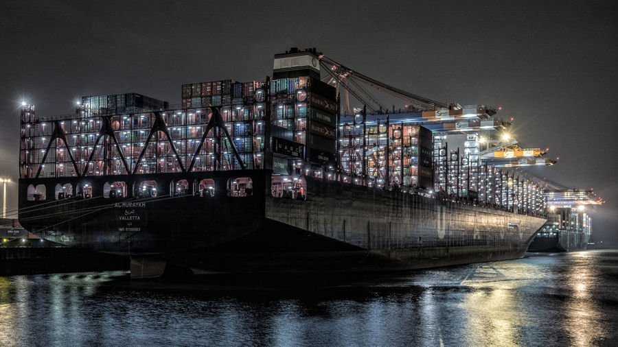 Container ships at harbor during night