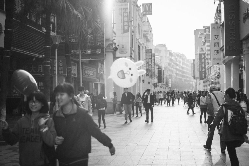 新會步行街 EyeEm EyeEm Selects EyeEm Gallery From My Point Of View Shopping The Week On EyeEm X-PRO2 Balloon Black And White Blackandwhite City City Life Crowd Enjoying Life Fujifilm Fujifilm_xseries Lifestyles Monochrome Outdoors Street Street Photography Streetphotography Walking