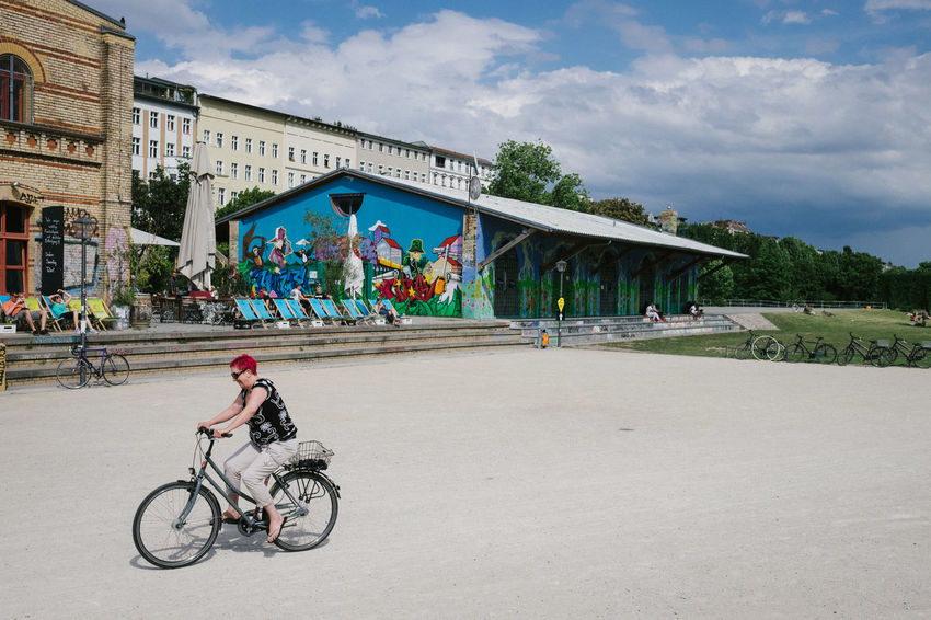 Berlin Bicycle Building Exterior Built Structure Capture Berlin City City Life Cloud - Sky Cycling Day Deutschland Germany Multi Colored One Person Outdoors Sky Tree