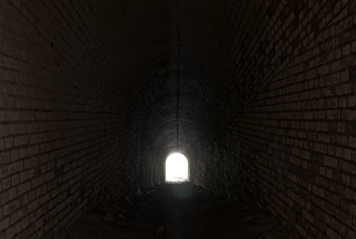 Into the light Brick Wall Low Light Architecture Atmospheric Brick Tunnel Built Structure Day Illuminated Indoors  Into The Light Light At The End Of The Tunnel Mysterious No People The Way Forward Tunnel Tunnel View Tunnels