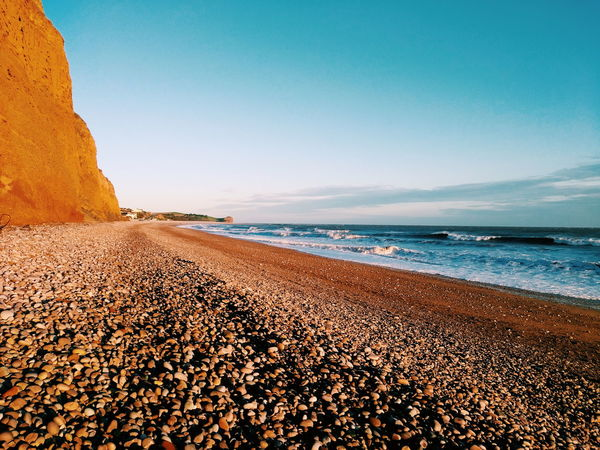 the beautiful Budleigh Salterton beach Pebble Beach VSCO Vscocam Vscogood Vscophile Beach Sea Sand Nature Sky Heat - Temperature Outdoors Scenics Pebble Day Horizon Over Water Blue Landscape No People Vacations Tranquility Travel Destinations Water Arid Climate Wave