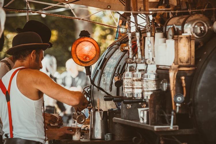Side view of man preparing coffee