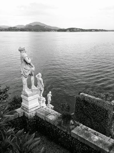 View Of Statues Overlooking Rippled Water