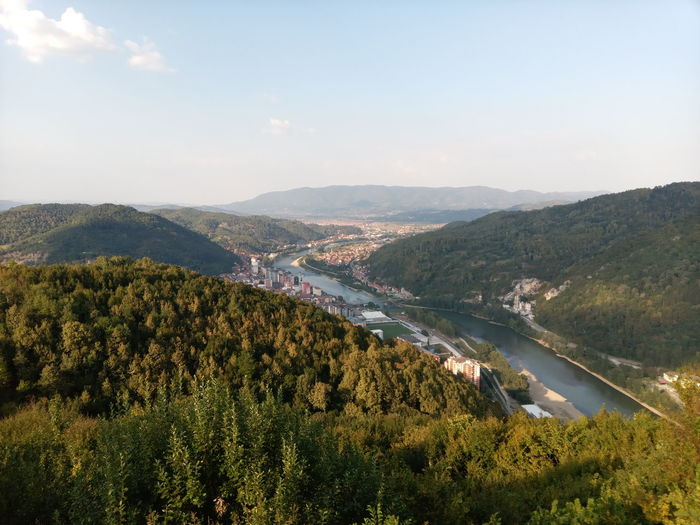 Scenic view of landscape and river against sky