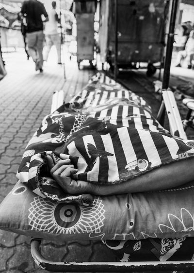 Sleeping on the street black and white