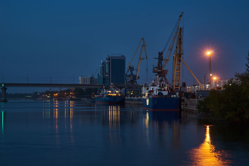 Evening dock view with ships and dockside cargo crane. astrakhan, russia