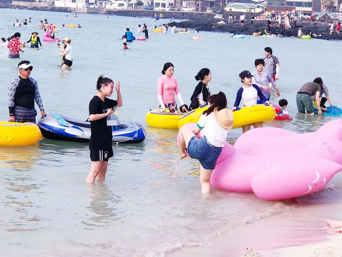 Beach photography series: Are you sure you able to climb in? Jeju Island, Korea My Asia Trip 2018 Travel Photography Outdoor Photography Water Real People Large Group Of People Group Of People Crowd Fun Day Nature Beach Lifestyles Enjoyment Leisure Activity Outdoors Sport Sea Land Childhood Women Men