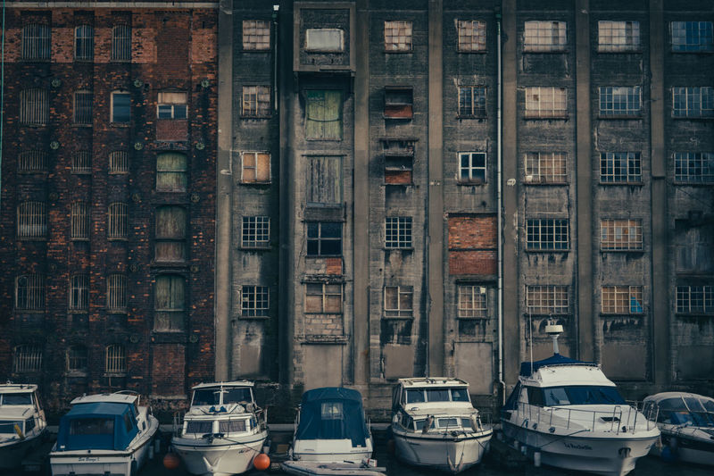 Boats moored outside a warehouse building in the dockyard area of Bristol in the United Kingdom. Architecture Boat Boats Boats And Moorings Building Built Structure City City Life Day Docks Exterior Mode Of Transport No People Outdoors Stationary Travel Destinations First Eyeem Photo