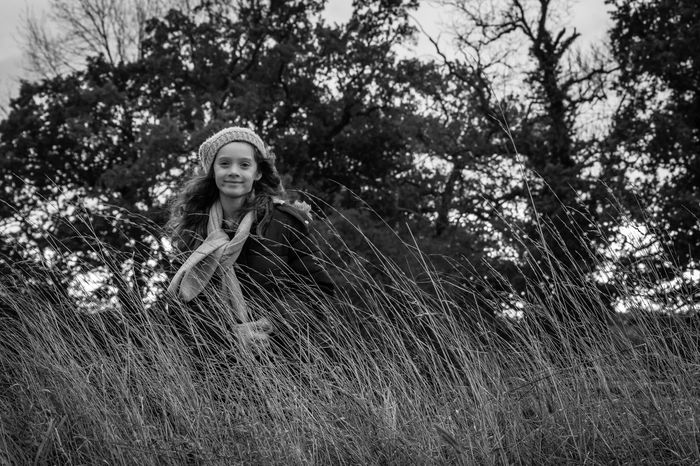 Autumn Black And White Childhood Day Grass Hat Innocence Long Grass Low Angle View Nature One Person Outdoors Scarf Tree Wind