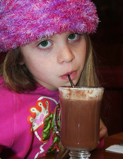 Portrait Of Girl Sipping Hot Chocolate Drink