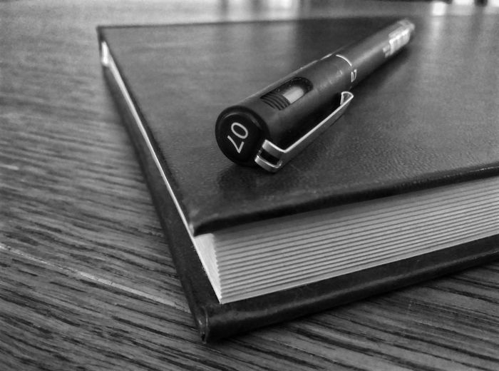 Pen on a closed notebook black and white Office Buisness Ink Inkpen Notebook Pen On A Book Table Notebooks  Notebook Cover Close Up Closeup Blackandwhite Black And White Black & White Blackandwhite Photography Black Black And White Photography Black&white Blackandwhitephotography Table Pen Indoors  No People Note Pad Diary Close-up