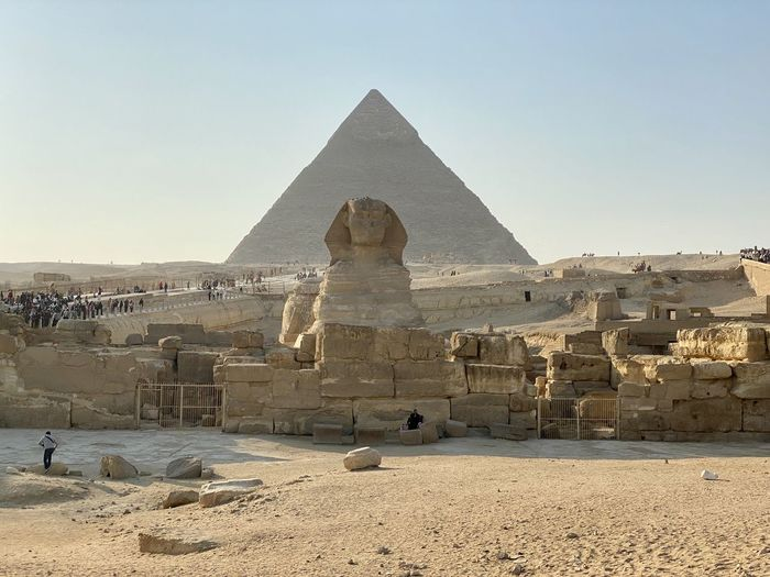 Sphinx and pyramid of khafre against clear sky