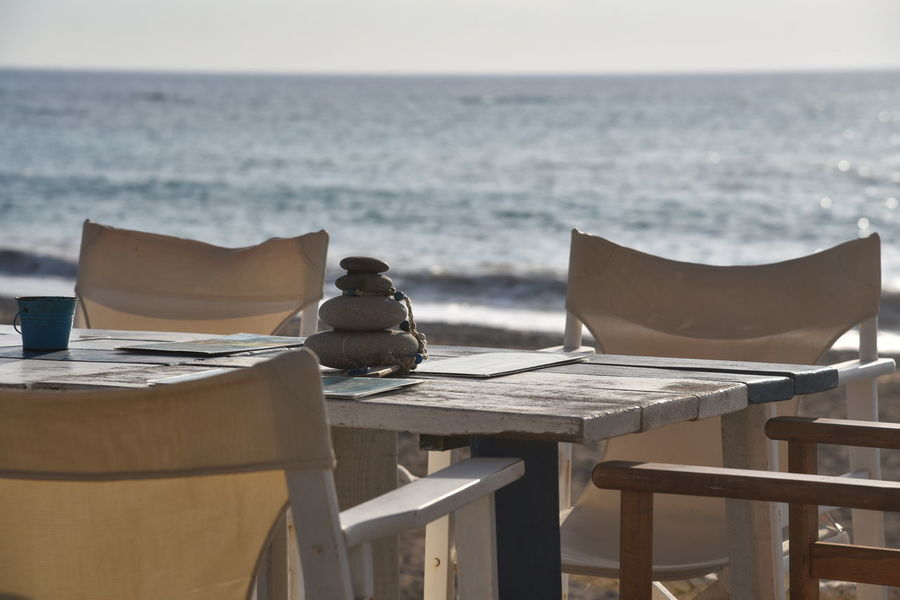 Cyprus Meer Strand Stühle Beach Beauty In Nature Chair Close-up Day Horizon Over Water Meerblick Nature No People Outdoors Scenics Sea Sky Steine Strandbar Table Tisch Tranquility Water Wood - Material Zypern