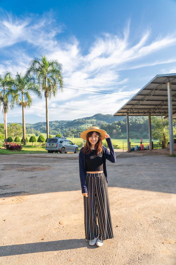 Portrait Women Thailand One Person Tree Real People Palm Tree Young Adult Standing Leisure Activity Sunlight Looking At Camera Young Women Front View Tropical Climate Sky Nature Day Plant Casual Clothing Lifestyles Outdoors Beautiful Woman Beautiful