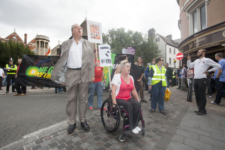 Taken during an anti-austerity march in Cambridge. Adult Anti Facism City Day Differing Abilities Freedom Of Assembly Freedom Of Expression Freedom Of Speech Full Length March Outdoors People Rally Real People Reflective Clothing Wheelchair