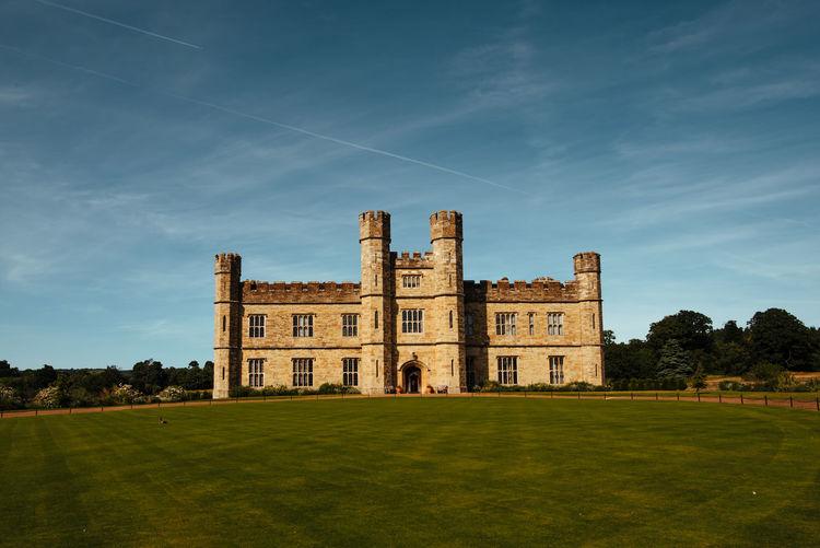 Castle on field against sky