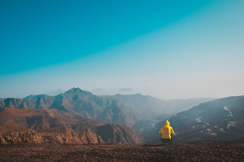 Person at the viewing deck enjoying the beautiful view Rasalkhaimah JebelJais Sunset Adventure Outdoors UAE Travel Destinations Tallest Mountain In UAE EyeEm Selects Tree Mountain Fog Full Length Rural Scene Forest Sky Landscape Hiker Countryside Mountain Range Calm Hiking Rocky Mountains Tranquil Scene Mountain Road Mountain Peak The Great Outdoors - 2018 EyeEm Awards