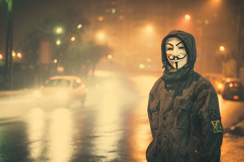 Anonymous is in town tonight. #pelephotography Anonymous Anonymous Mask Mask Masks Masked Rebel Rebellion City Men Winter Smiling Males  Portrait Street Halloween Snowcapped Snowflake Snowing Snow Covered