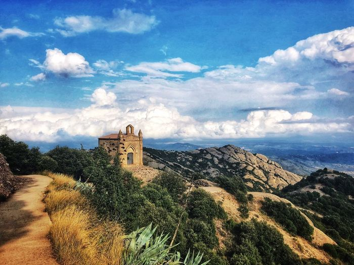 A small chapel on top of one of the cliffs of the Montserrat mountain in the background of clouds Spain. Beauty In Nature Nature Mountain Cloudy Chapel Montserrat Cloud - Sky Sky Architecture Building Exterior Built Structure Nature Building Plant Tree No People Day The Past Beauty In Nature History Sunlight Religion Travel Destinations Tranquility Outdoors Travel My Best Photo My Best Photo My Best Photo