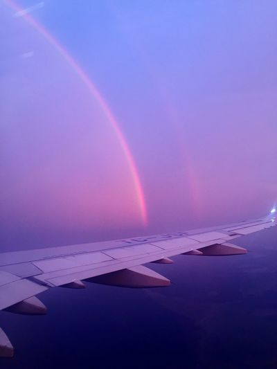 Scenic view of rainbow over airplane