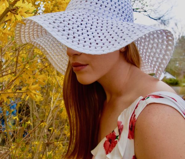 Beauty In A Hat Beautiful Woman Close-up Day Focus On Foreground Hat Headshot Leisure Activity Lifestyles Nature One Person Outdoors People Real People Standing Sun Hat Women Young Adult Young Women