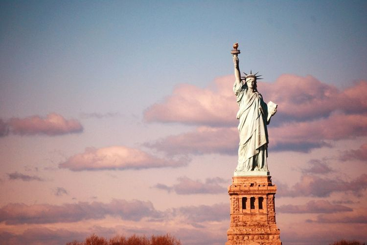 Lady Liberty in Her Glory EyeEmNewHere PhotosbyKelli Statue Human Representation Female Likeness Sculpture Sky Cloud - Sky Art And Craft Sunset Low Angle View Travel Destinations No People Outdoors Architecture Day Mountain Nature