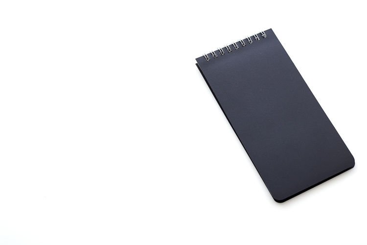 Top view Blank notepad on white background School Notebook Business Workplace Office Object NotePad White Background Paper Blank Note Isolated Spiral Book Pad Page Top View Empty Space Desk Sheet Design Template Document Diary Copy Table Open Pen Education Message Mockup Pencil Write Clean Binder Concept Textbook Copy Space White Background Studio Shot Single Object Cut Out Black Color Still Life Indoors  No People Close-up High Angle View Communication Technology Publication