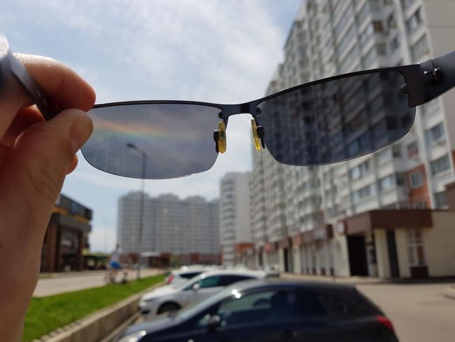 Glassess Glasses Reflections Rainbow Polarization Filter Clear Sky Rainbow Car Building Exterior City Human Body Part Built Structure Architecture Outdoors Adult Day People One Person Human Hand Water Adults Only One Man Only Sky Only Men Close-up