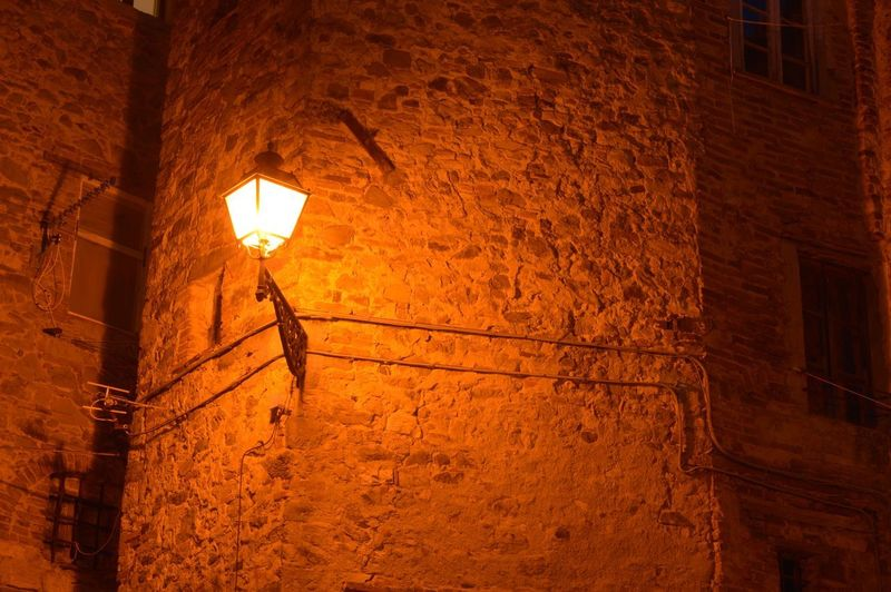 Lighting Equipment Illuminated Architecture Built Structure Wall - Building Feature Wall Low Angle View Electric Lamp Building Exterior Street Light Night Street Brick Wall Electricity  Electric Light Glowing
