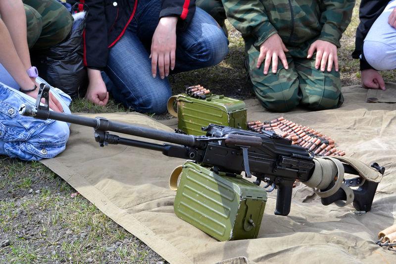 People By Machine Gun On Field