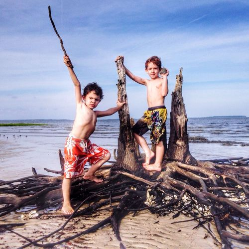 Boys playing by water Enjoying Life Port Royal Sound Childhood Stick Beach Sand Sky Water Outdoors Boys Brothers Childhood Tree Roots  Positive Emotion Emotion Day Child Shirtless Family Togetherness Two People Full Length Land Nature Sea
